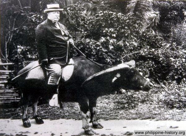 Picture of General William Howard Taft riding a water buffalo in the Philippines